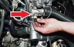 Где находится датчик температуры двигателя